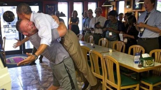 Obama-gets-bear-hug-by-pizza-shop-owner.-Photo-by-Saul-Loeb_AFP-e1347231698947