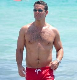 Andy-cohen-shirtless-miami-red-swimsuit-04182011-02-435x580