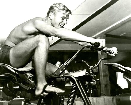 TAB-HUNTER-EXERCISE-BIKER-SHIRTLESS