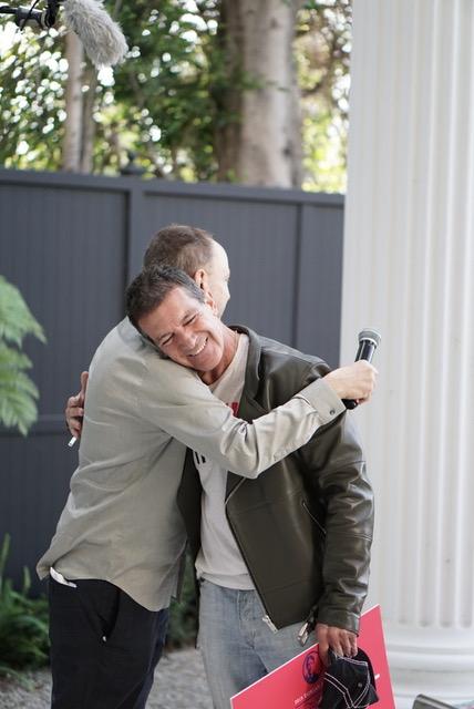 Banderas and GALECA Exec Director John Griffiths hug-boyculture